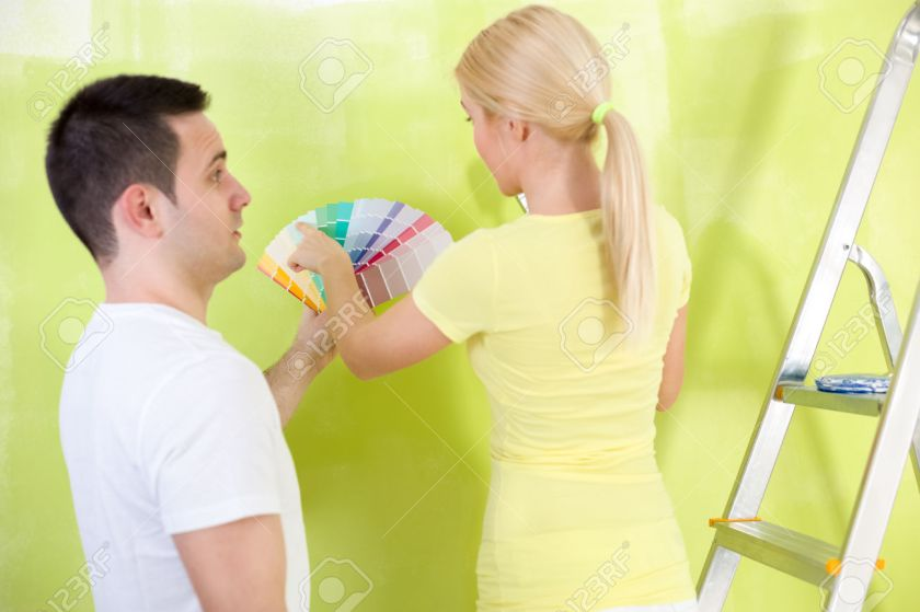 Couple choosing paint for painting